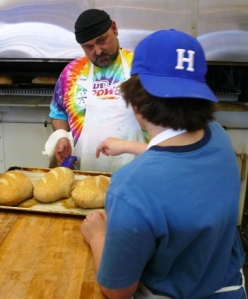 Taking the bread's temperature with Baker Michael (yes, that's Andrew's bread)